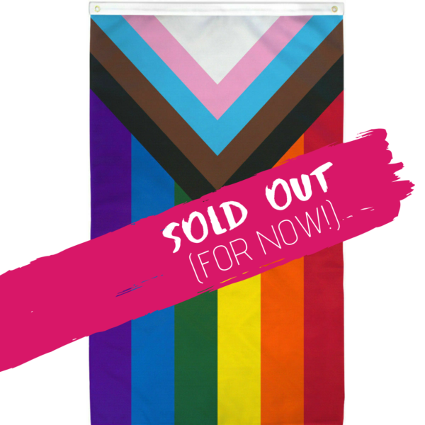 a rainbow flag with an inward-pointing triangle at one end, which consists of black, brown, and trans flag color stripes, the words SOLD OUT FOR NOW appear over the flag image