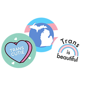 "3 buttons, one with a heart that reads ""Trans Cutie,"" one with a silhouette of Michigan in trans colors, and one with a trans rainbow that reads ""Trans is Beautiful"""
