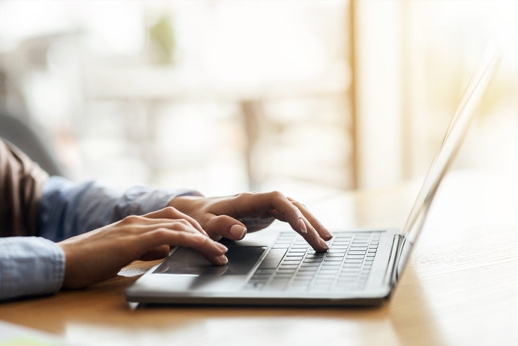 Stock Photo of Person on Computer